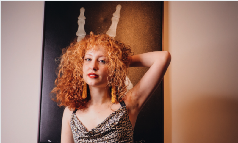 woman with beautiful red curly hair